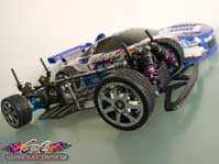 Lire l'article Yokomo YR4 M2 – vintage rc - Piste DTM – sedan four wheel drive